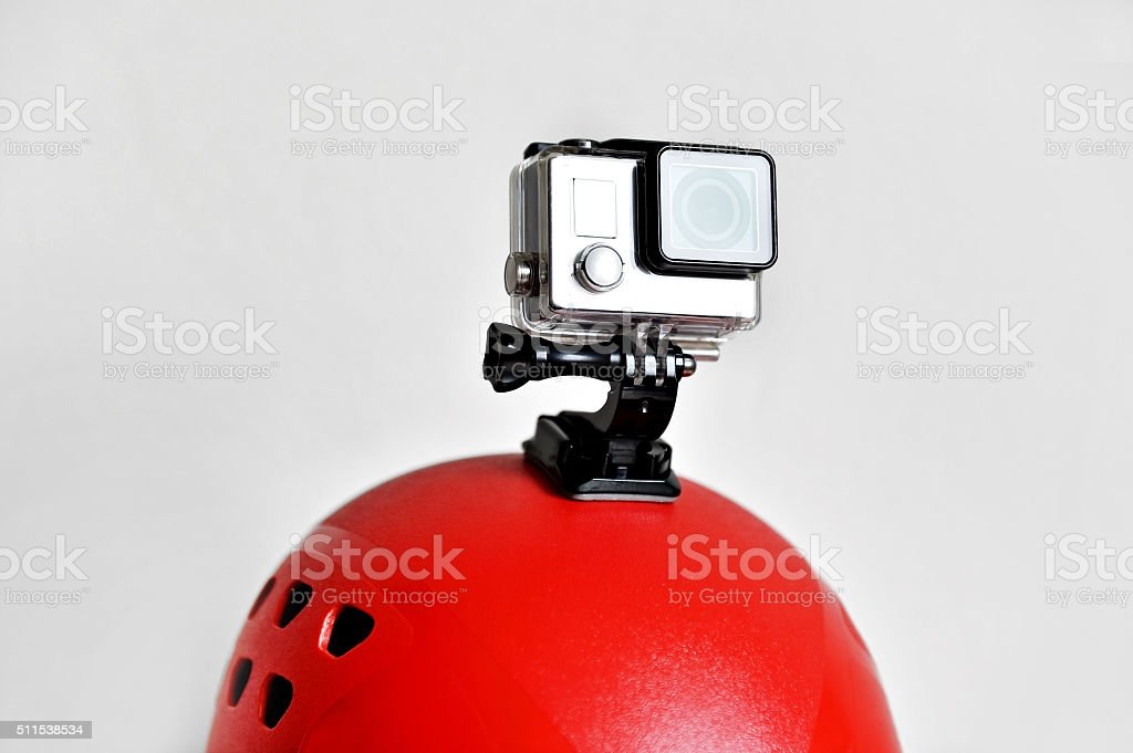 Action camera on red sport helmet stock photo
