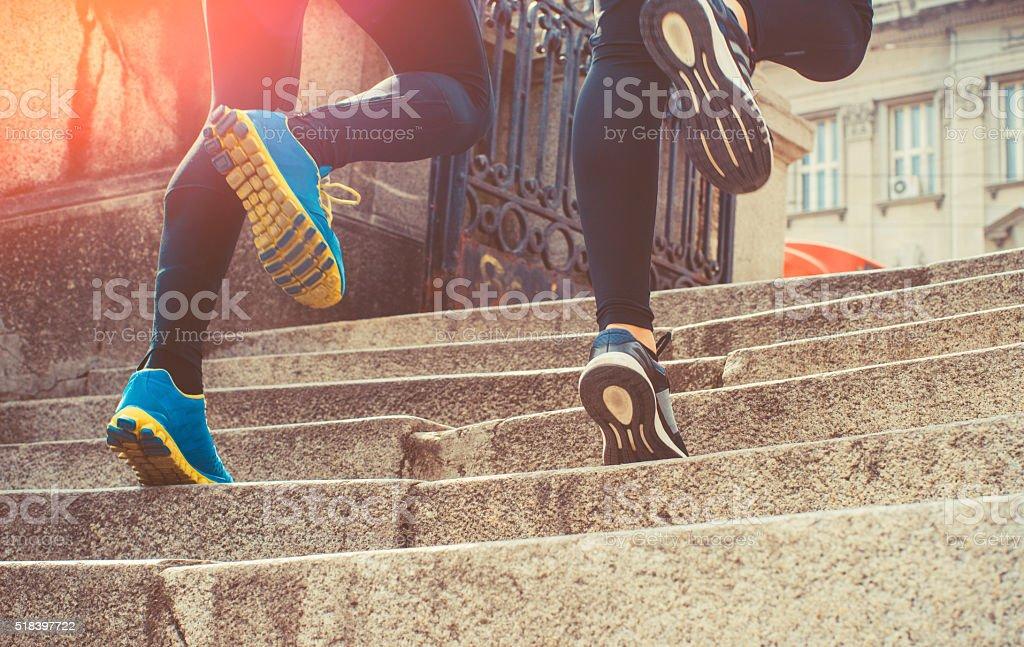action closeup of couple running stock photo