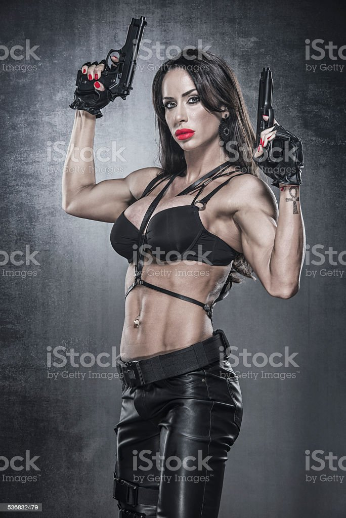 Beautiful Athletic Woman as Action Hero, holding two guns