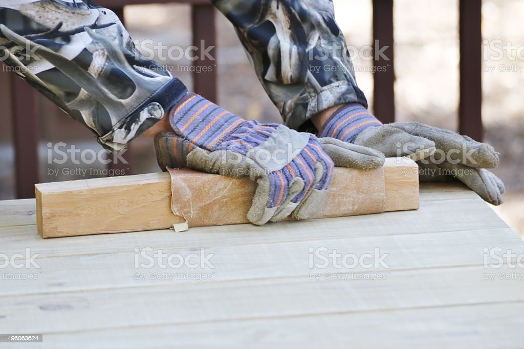 Action: Man sanding and painting stock photo