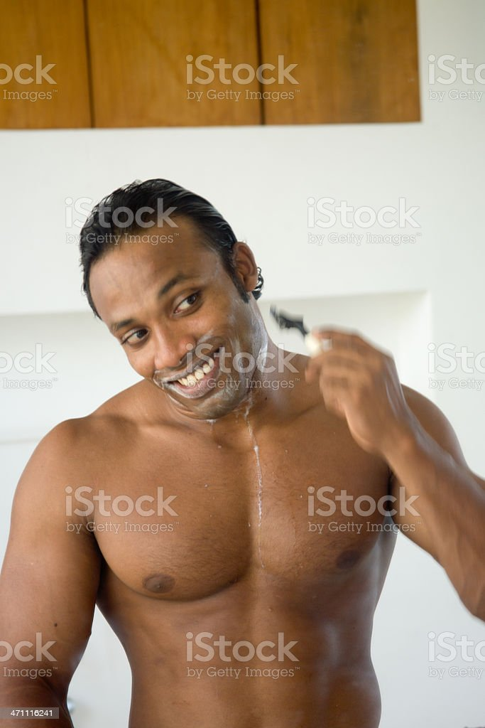 action man shaving in mirror stock photo