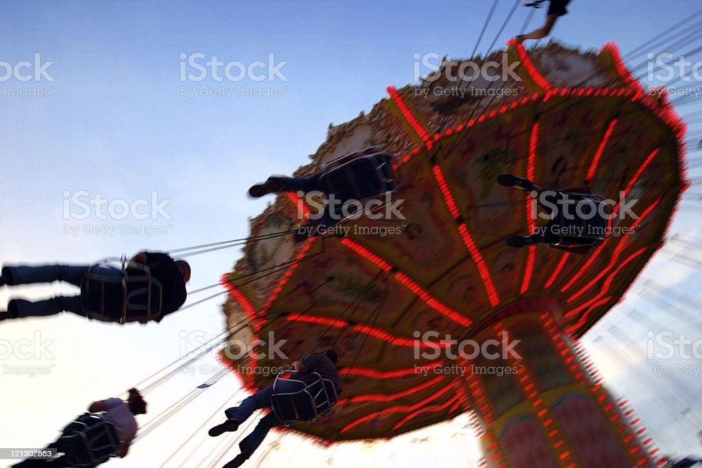 action photo of carousel/chairoplane royalty-free stock photo