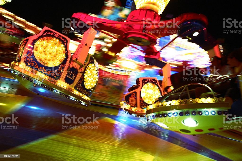 action photo of riding a merrygoround stock photo