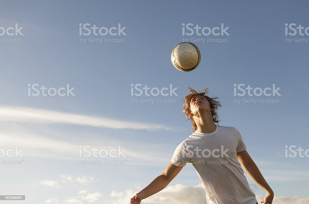 Action photo of soccer player getting ready to head he ball stock photo
