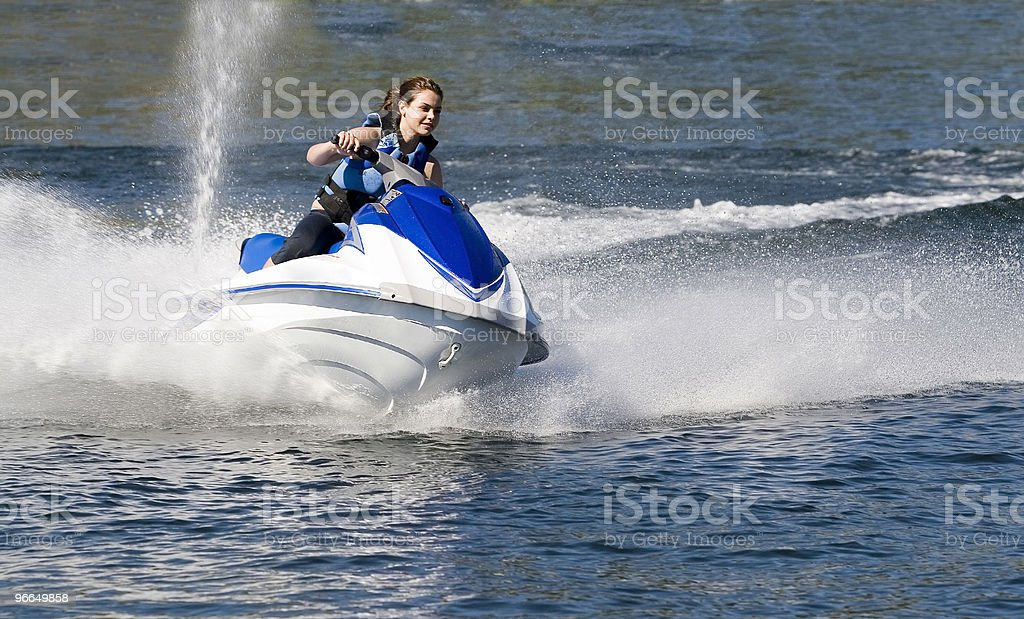 Action Photo of Young Woman on Seadoo stock photo