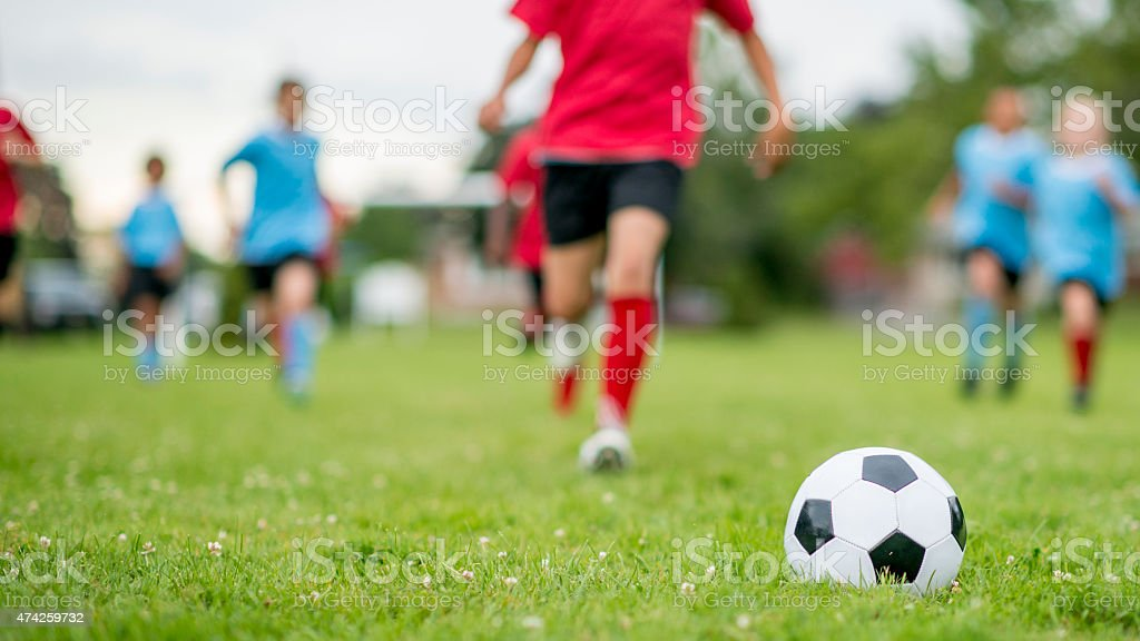 Action Shot of Kids Playing Soccer stock photo