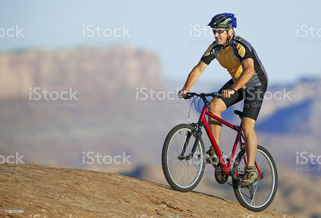 Action Shot Of Male Cyclist Riding Mountainbike In Moab, Utah royalty-free stock photo