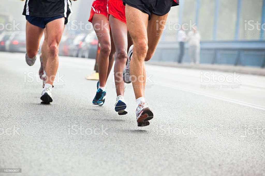 Action shot of people running in city marathon royalty-free stock photo