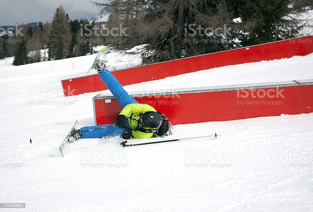 Action shot of skier falling off rail in a Snowpark stock photo