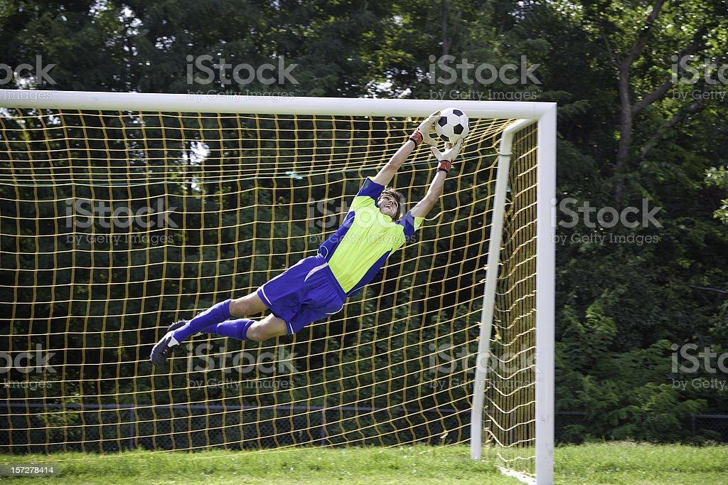 Action Shot of Soccer Goalie stock photo