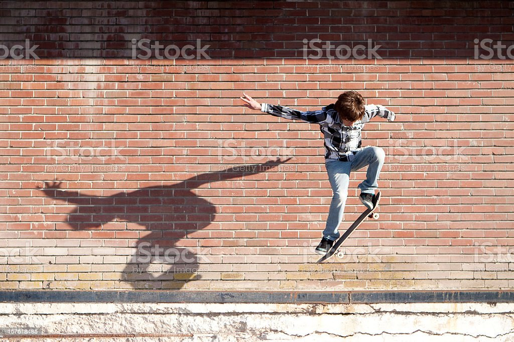 Action Shot of Teenage Male Skateboarder Jumping royalty-free stock photo