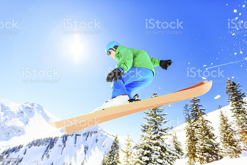 action shot of teenager jumping with his skis royalty-free stock photo