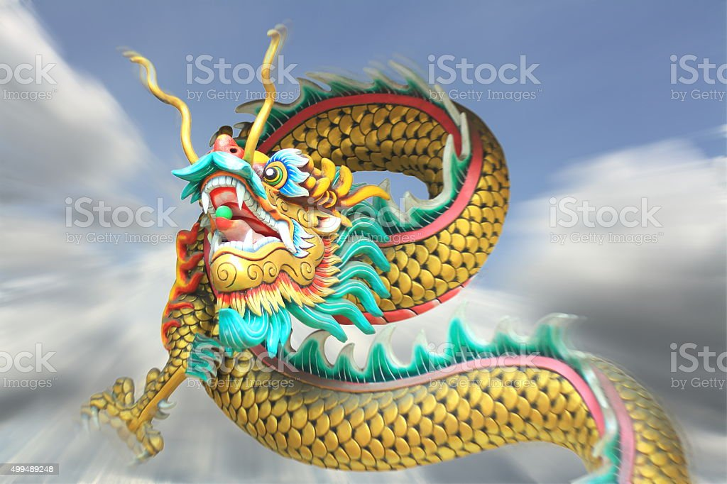 action zoom blurring china dragon statue flying in the sky. stock photo
