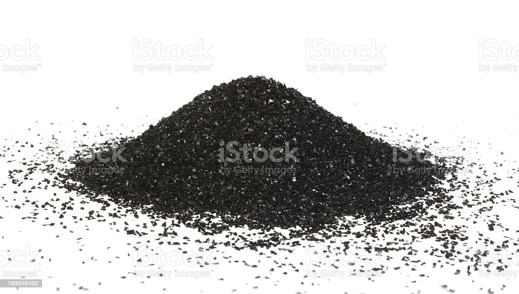 Activated carbon powder mound stock photo
