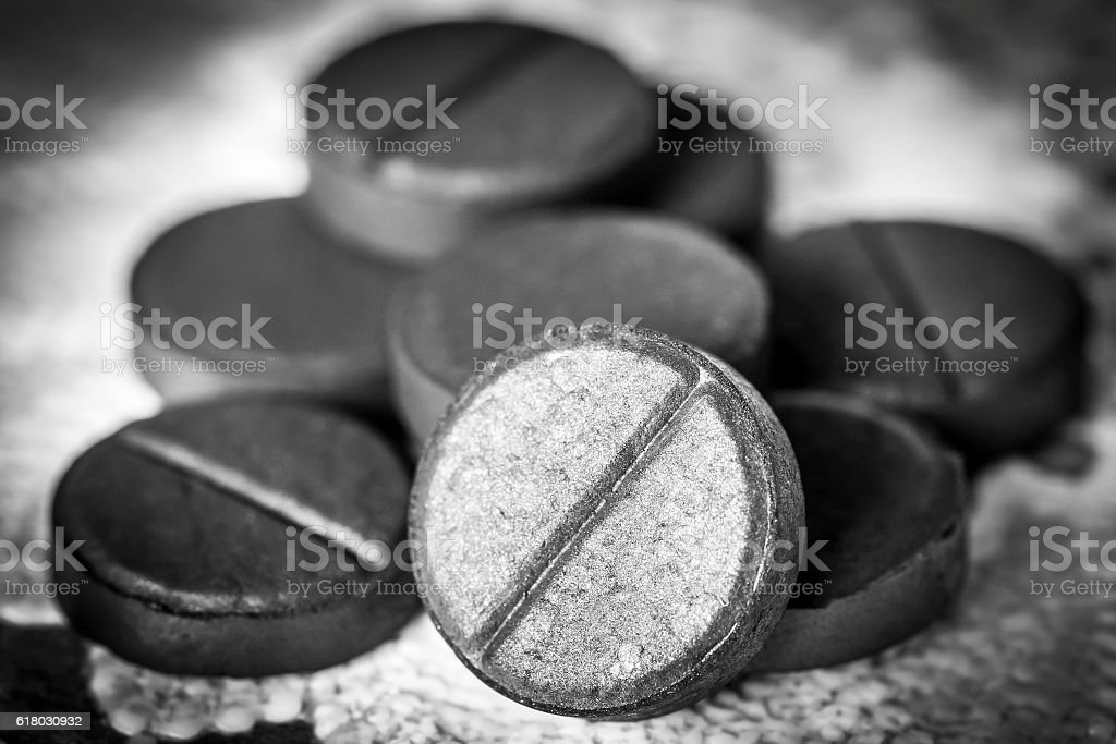 Activated charcoal tablets stock photo