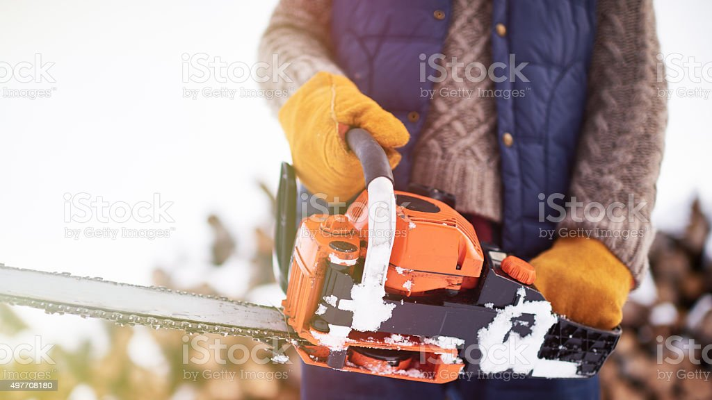 Activating chainsaw stock photo