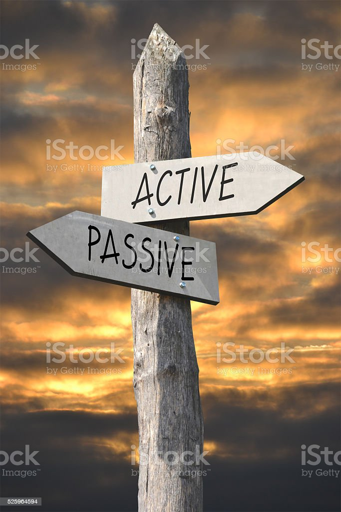 Active and passive signpost stock photo