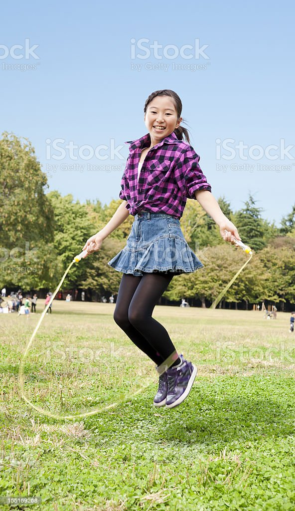 Active Asian girl with a jump rope stock photo