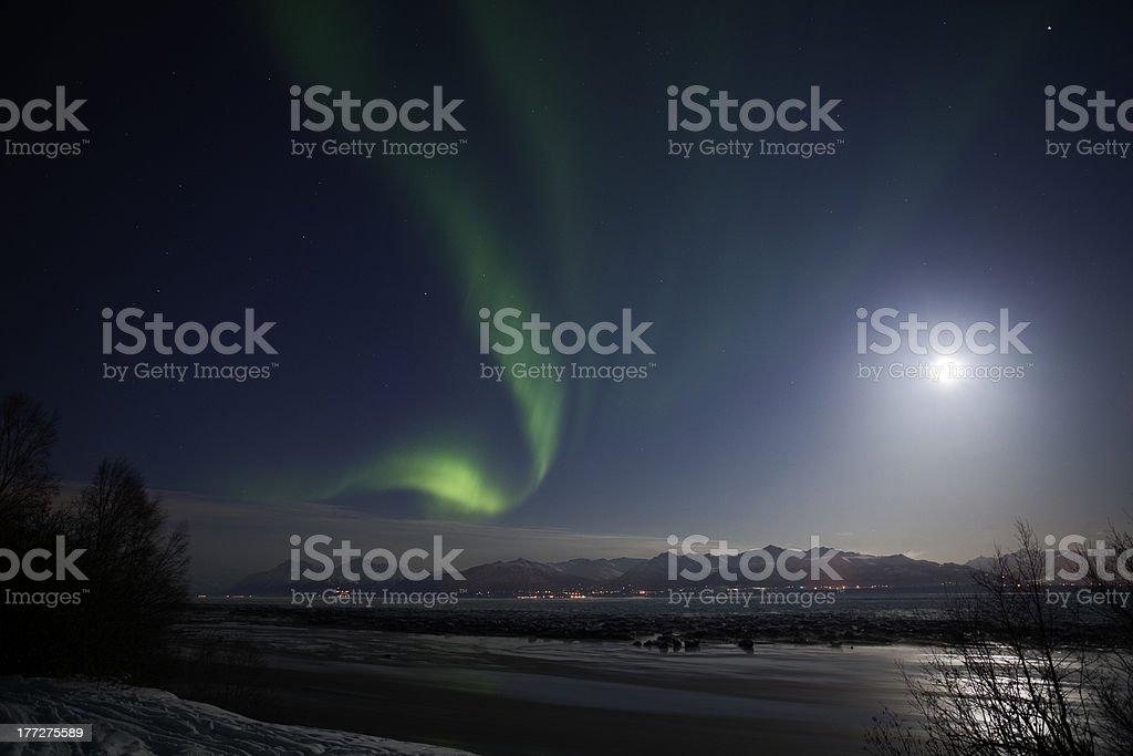 Active Aurora shines through Full Moon Light royalty-free stock photo
