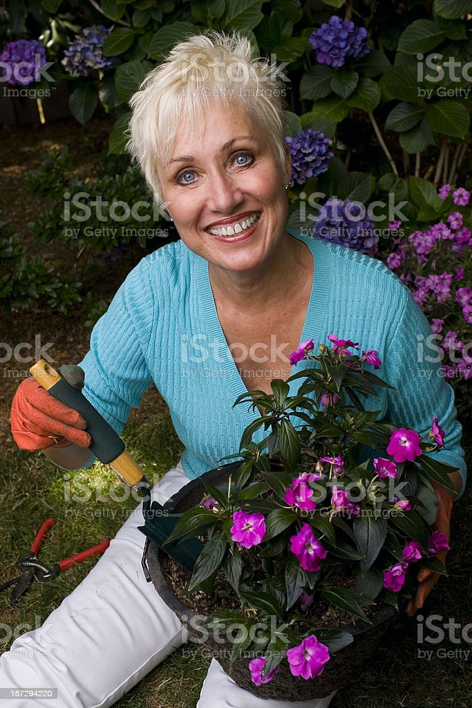Active Beautiful Senior Woman Gardening, Smiling at Camera royalty-free stock photo