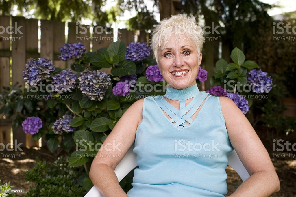 Active Beautiful Senior Woman Portrait Relaxing in Yard, Copy Space royalty-free stock photo