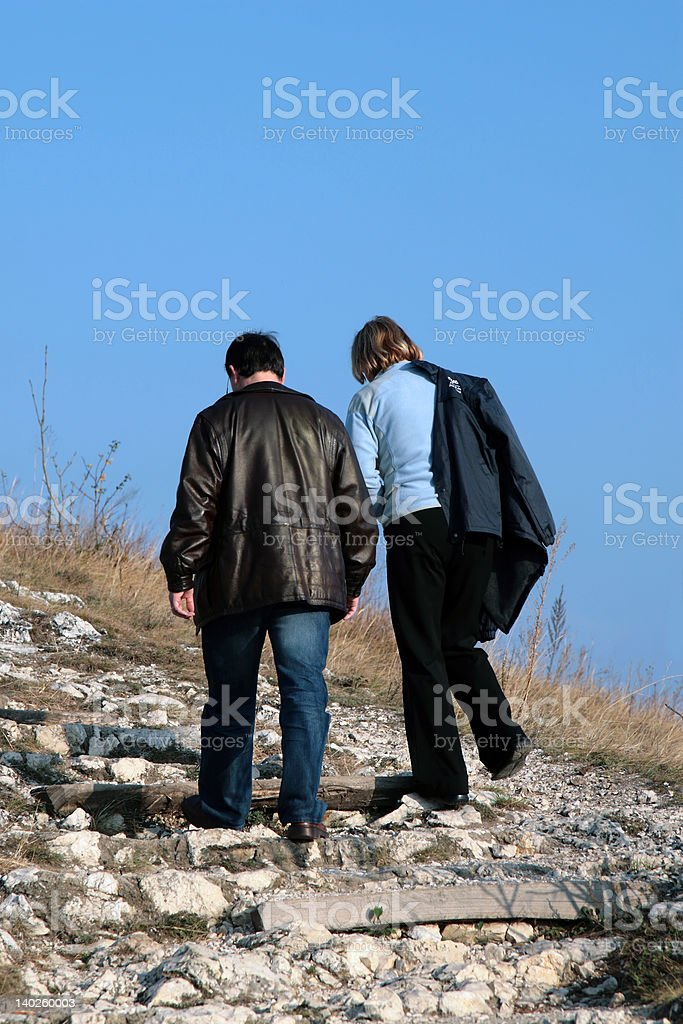 Active couple walking together in park royalty-free stock photo