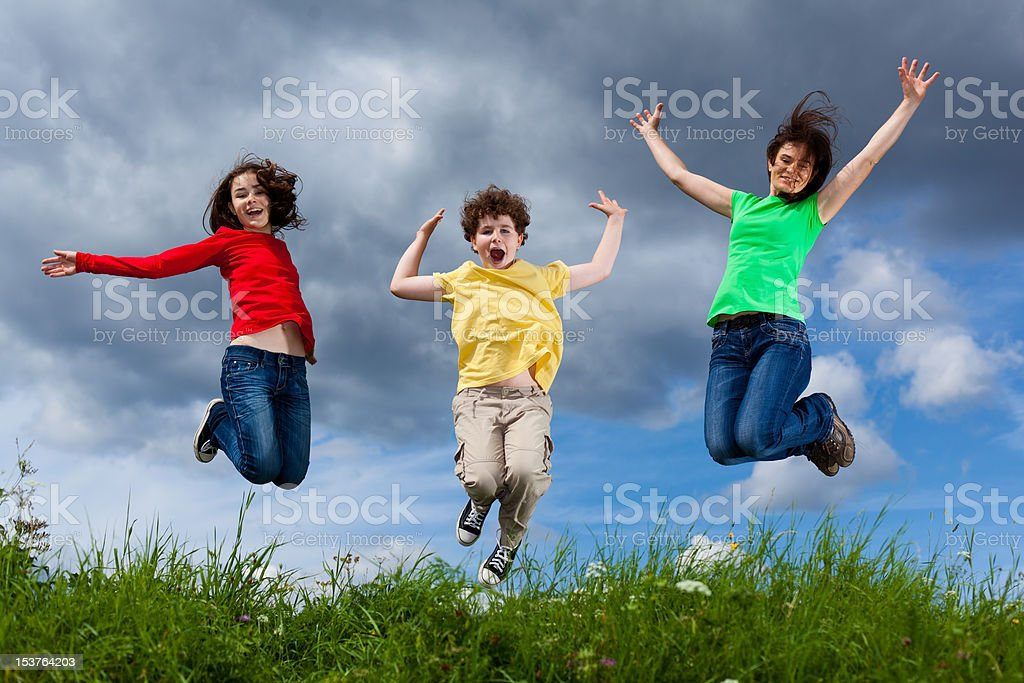 Active family jumping outdoor royalty-free stock photo