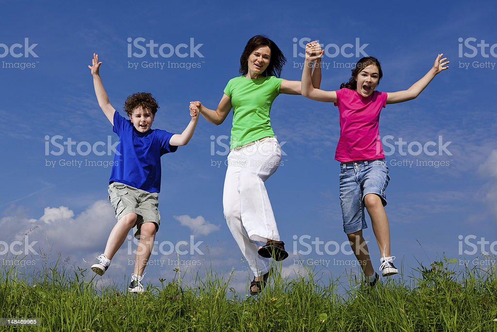 Active family jumping, running outdoor royalty-free stock photo