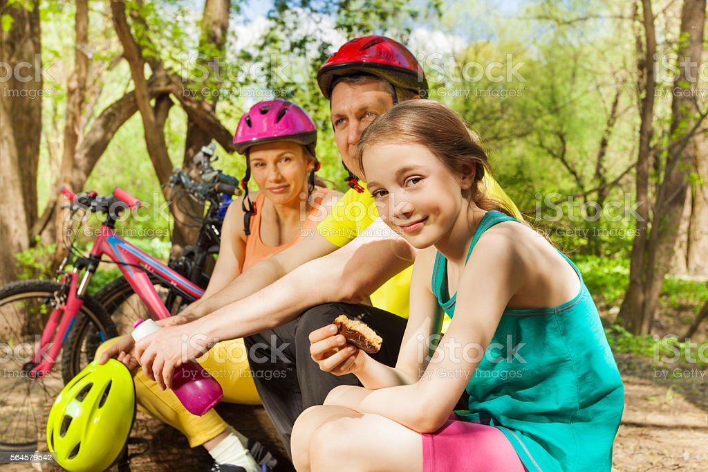 Active family refreshing after cycling in the wood stock photo