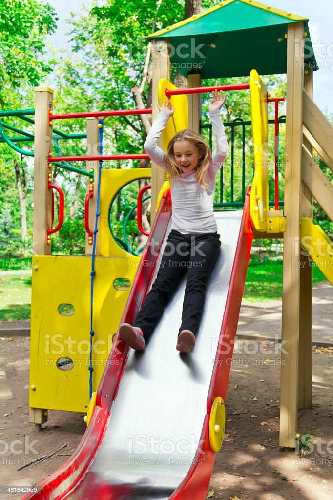 Active girl on nursery platform in summer stock photo