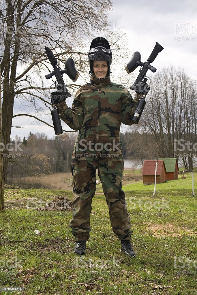 Active girl playing paintball. royalty-free stock photo
