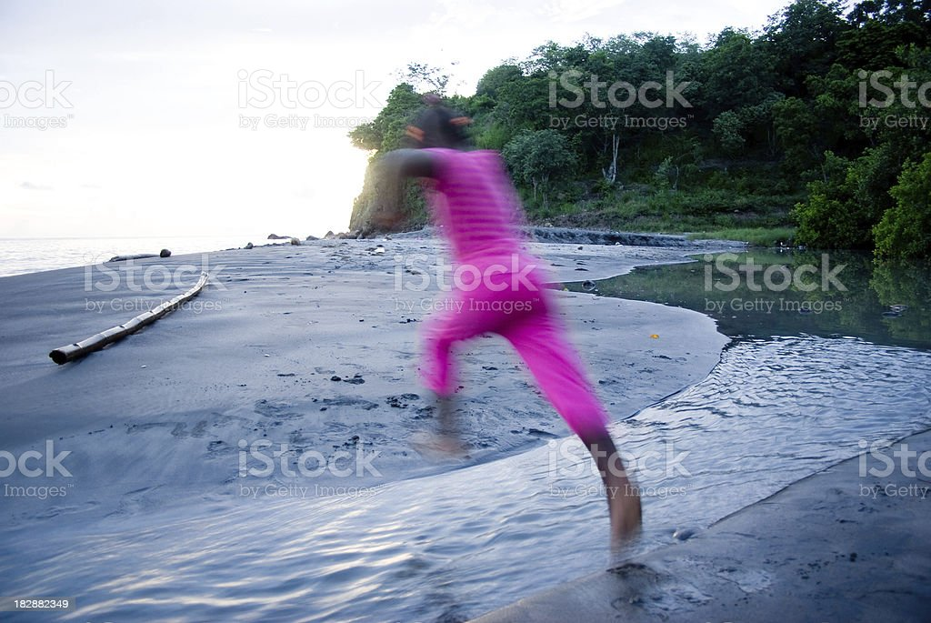 active lifestyle - crossing stream on beach stock photo