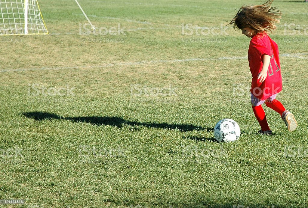 Active Little Girl Playing Soccer stock photo