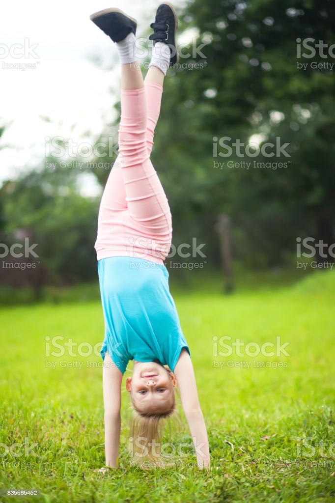Active little girl turning outdoors, sport and children stock photo