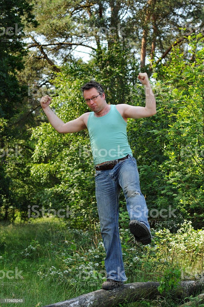 Active man showing his muscles during exercising outdoors royalty-free stock photo