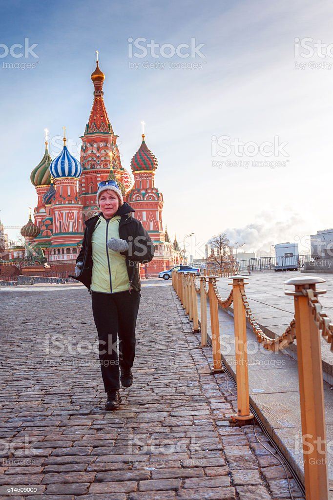 Active Mature Woman Running, St Basils Cathedral, Moscow, Russia stock photo