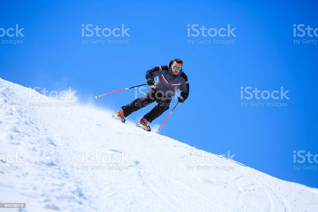 Active men snow skier skiing Sunny ski resorts stock photo