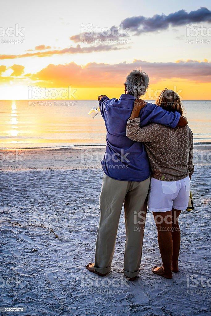 Active retirees enjoy the sunset on Siesta Key beach FL stock photo