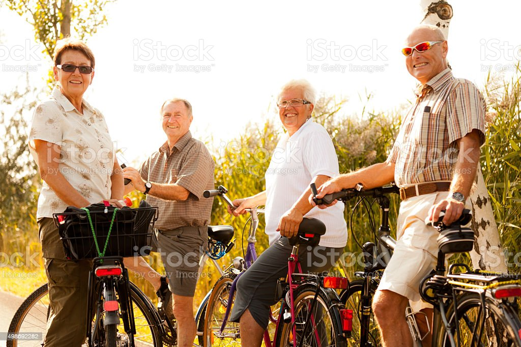 active retirees on bicycles stock photo