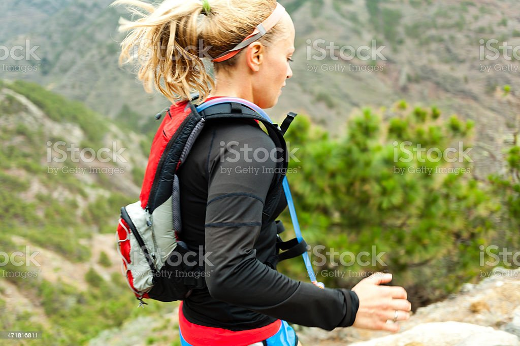 Active runner trailing the mountains in the afternoon  royalty-free stock photo