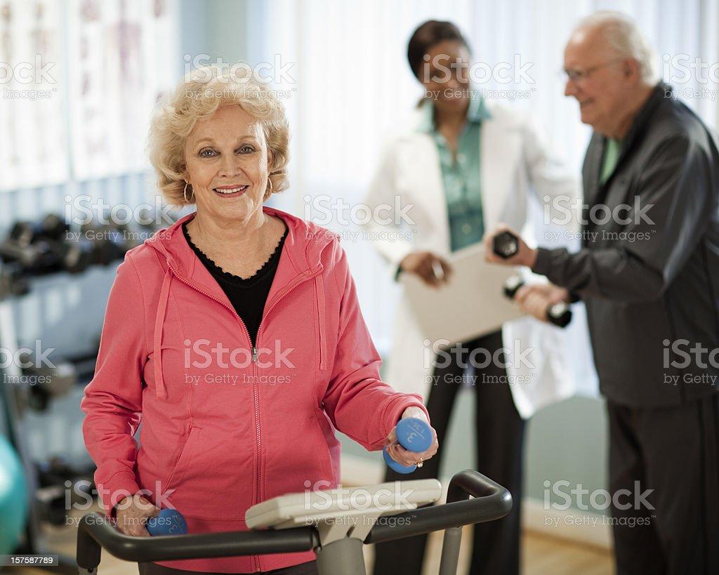 Active Senior Couple Exercising stock photo