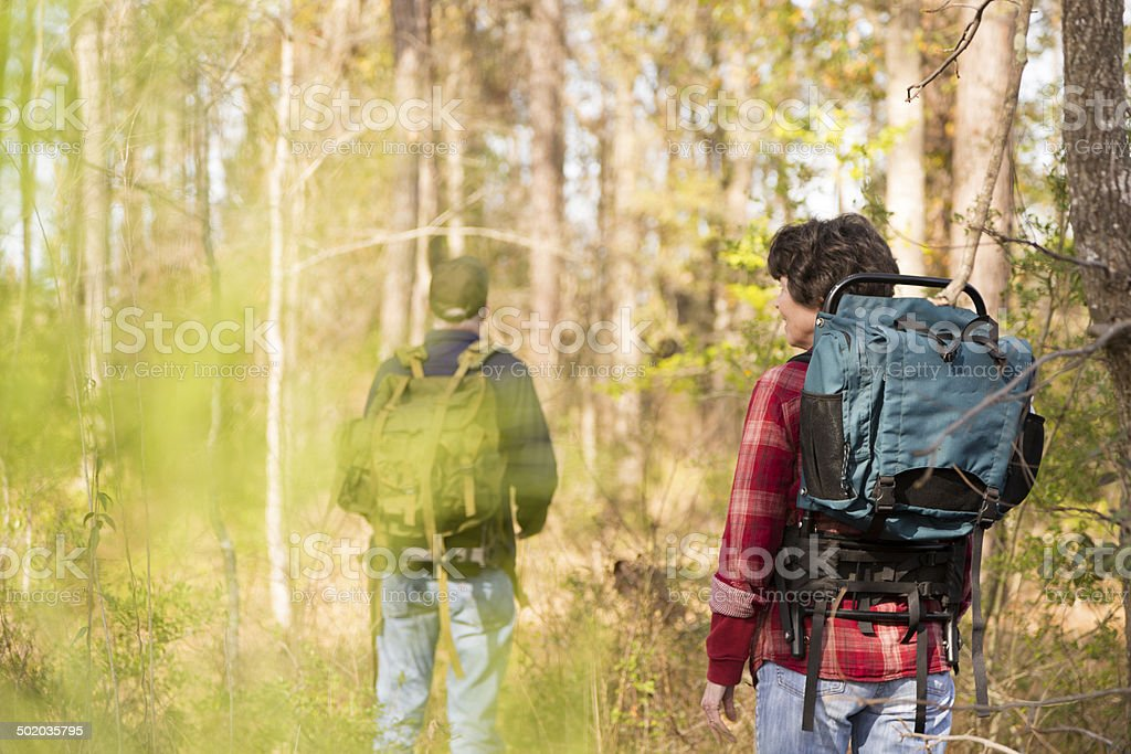 Active senior couple outdoors hiking in forest.  Nature. royalty-free stock photo