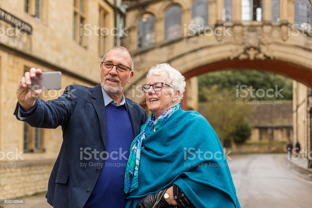 Active Senior Couple Taking Selfie at Bridge of Sighs stock photo