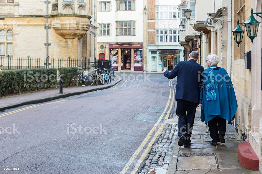 Active Senior Couple Walking on the Streets of Oxford, UK stock photo