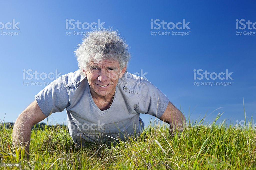 active senior doing push-ups royalty-free stock photo