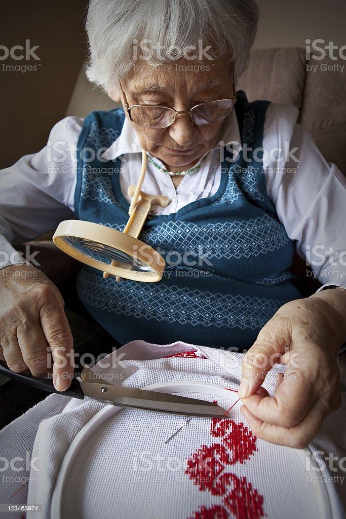 Active Senior Embroidering stock photo