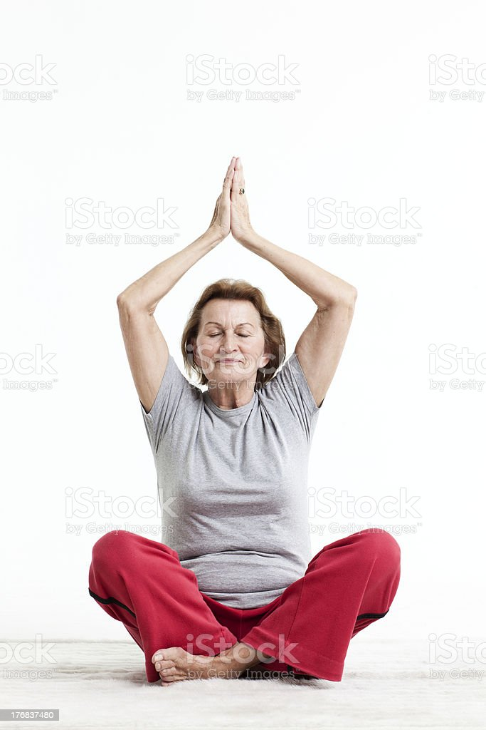 active senior in yoga position stock photo