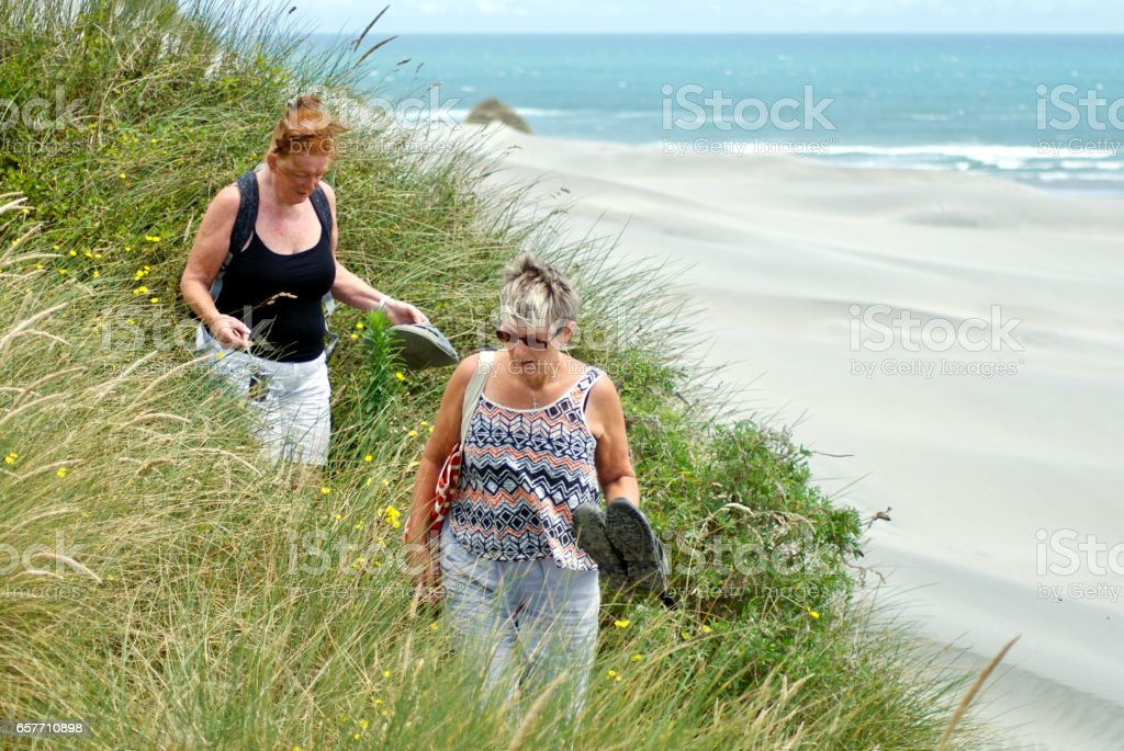 Active Senior Ladies on Sand Dunes stock photo