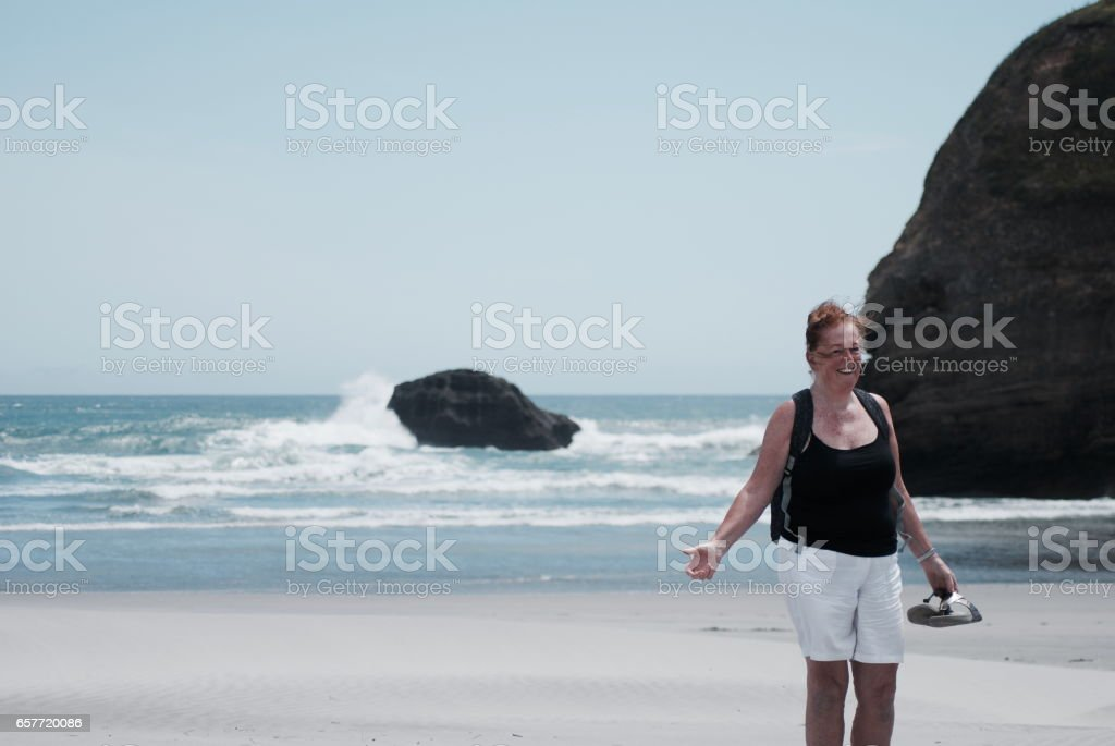Active Senior Lady by the Sea stock photo