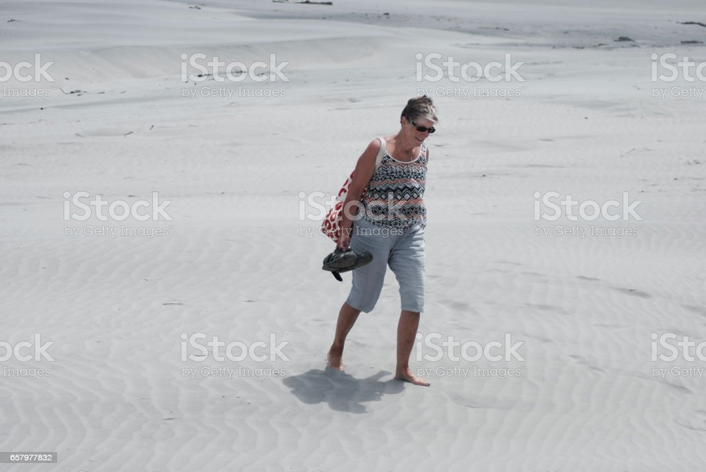 Active Senior Lady in the Sand stock photo